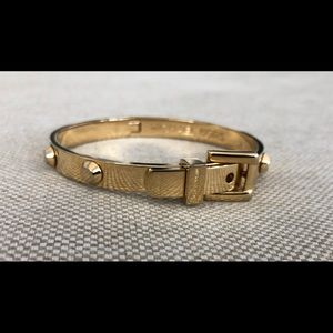 Michael Kors gold buckle bangle.